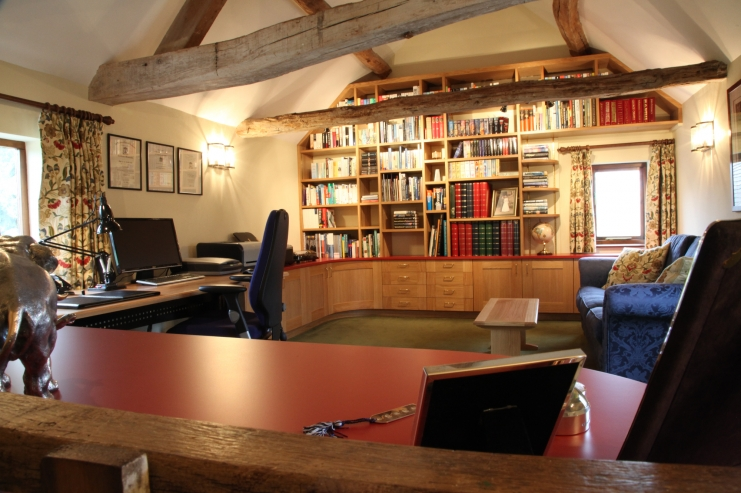 European Oak Study With Eye Catching Red Finish. Tailored Veneered  Bookshelves. Sweeping Curves Of The Oak Cabinetry. Bespoke Home Office  Furniture