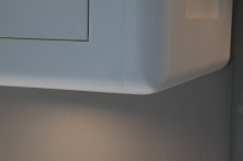 Kitchen cabinetry with skilfully rounded corners throughout