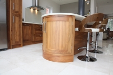Curved handcrafted walnut unit