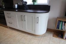 Curved hand-painted kitchen cabinetry