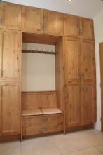Bespoke furniture with seating, shoe storage and tall cupboard for utility room