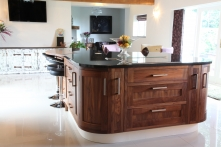 Stunning large curved island with wide-pan drawers and pull-out cupboards