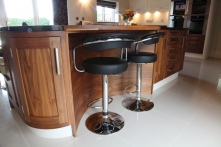 Curved breakfast area with walnut surface