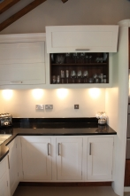 Hand painted cabinets with folding doors