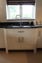 Extending sink unit and cabinets