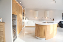 Bespoke curved oak and light granite island