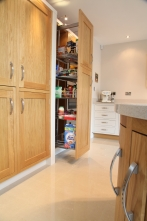 Tall pull out storage cupboard