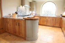 Rounded base unit of oak, hand painted and granite