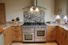 Range with Juperana Perla granite splash back