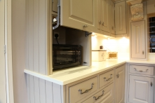 Tastefully hidden appliance with lifting panelled door