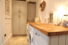 Utility room with with same distressed finish and wooden surfaces