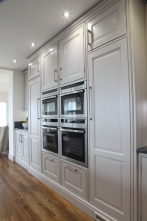 Miele ovens flanked by tall larder and integrated fridge freezer