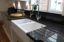 Stunning double sink with granite draining surface