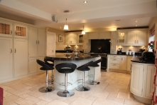 Stunning hand painted kitchen with Nero Angolan granite surfaces