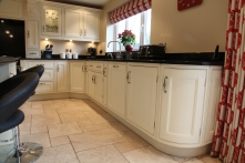 Curved appeal throughout with beautiful end cabinets