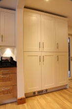Floor to ceiling cabinetry in Farrow and Ball's White Tie paint