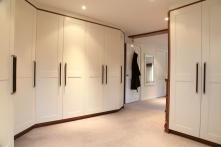 Double backed wardrobes create a stunning dressing room area