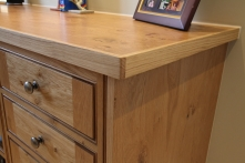 Desk tops are veneered oak with solid lipped edge