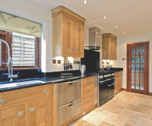 Light Oak cabinetry complimented by dark granite surfaces