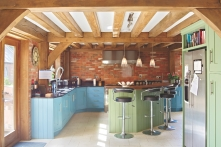 Stunning vibrant kitchen in oak timber-framed house