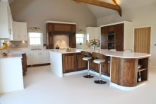 Open plan walnut and hand-painted kitchen