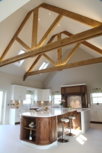 Striking wooden beams with equally striking walnut units