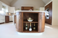 Display case fitted with curved cabinets in the end of the island