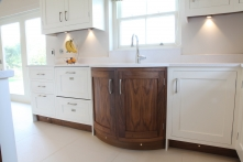 Curved walnut sink cabinet