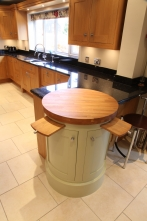 Iconic round end cabinet