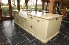 Fabulous hand-painted island with a myriad of cupboards