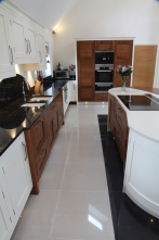 Contemporary kitchen in walnut and painted finish