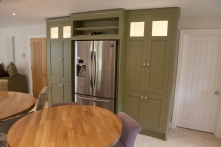 Tall cabinetry in Farrow & Ball Olive Paint