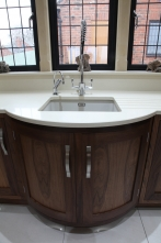 Curved sink cabinetry
