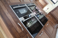 Appliances in stunning walnut surround