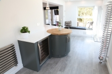 Curved hand-painted cabinetry with integrated wine cooler