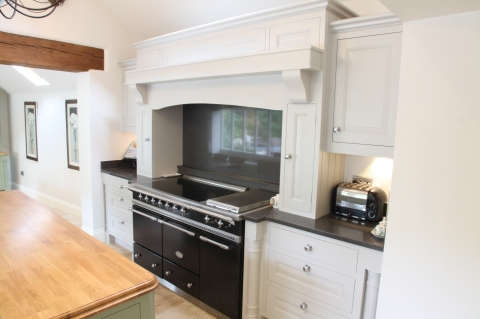 Range cooker with hand crafted mantle and extractor